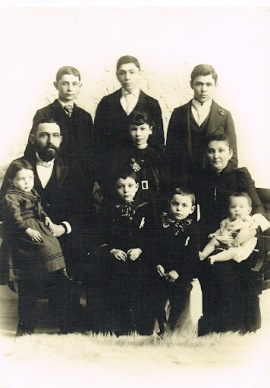 (back l-r) Ben L, Lou and Ike; (front) Ben holding Henry, Collie, Nate and Yetta holding Moe. Lena is center, in front of Lou