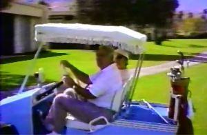 Myndal and Gilbert in Golf Cart